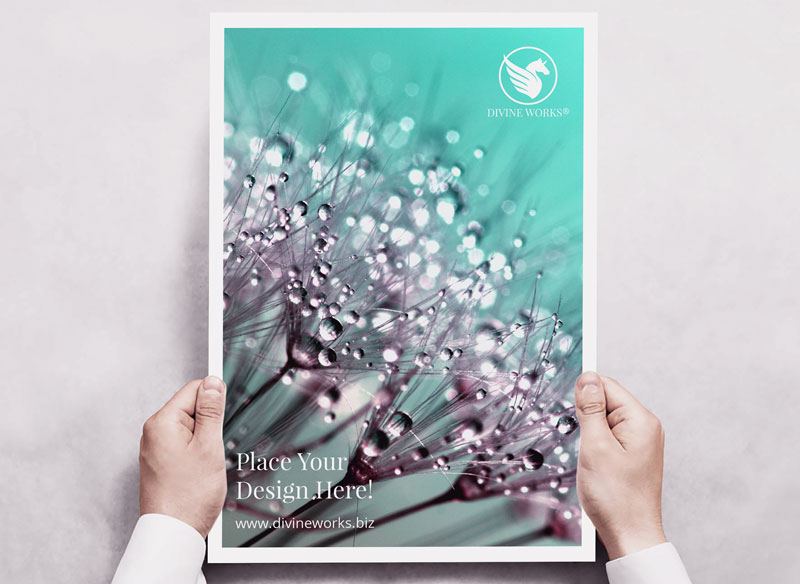 Free Poster In Hand Mockup by Divine Works